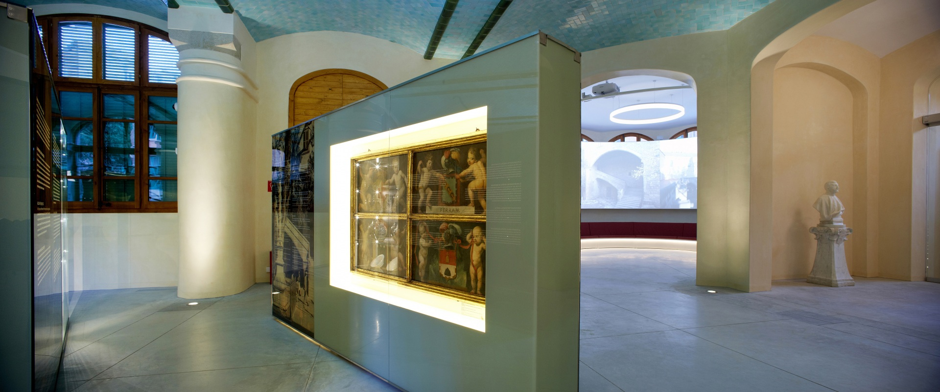 Hospital of the Santa Creu i Sant Pau. Exhibition on the history of the hospital. Panel with classical paintings. On the background, bust and projection 360º.