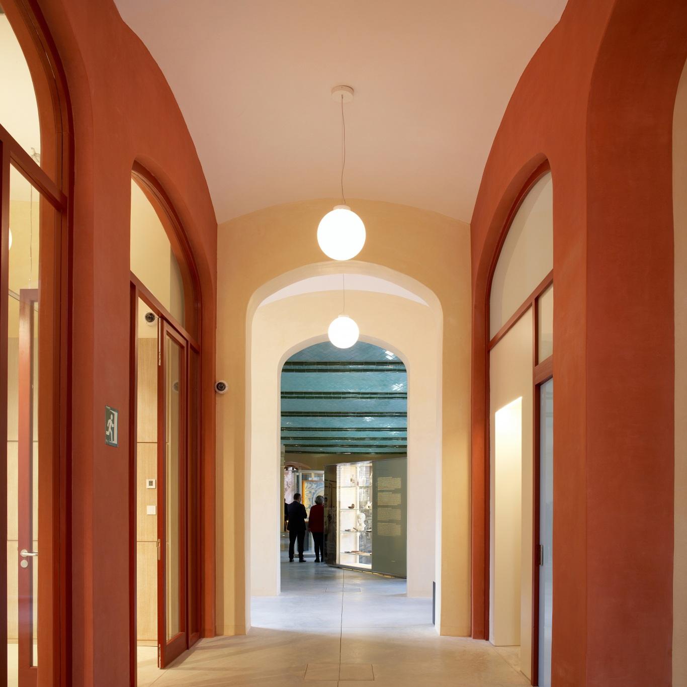 Hospital of the Santa Creu i Sant Pau. Access to the medicine exhibition. Arches on red and yellow painted wall.