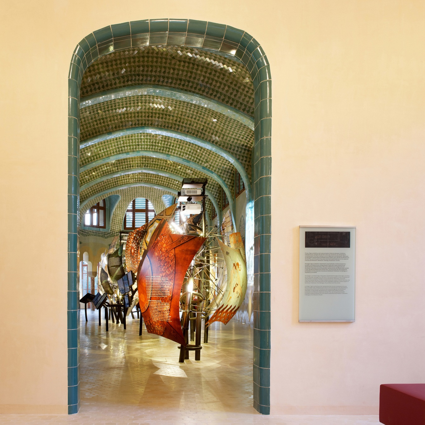 Hospital of the Santa Creu i Sant Pau. Access to the dragon exhibition. Dragon\'s structure illuminated over the pavilion\'s ceramic interior.