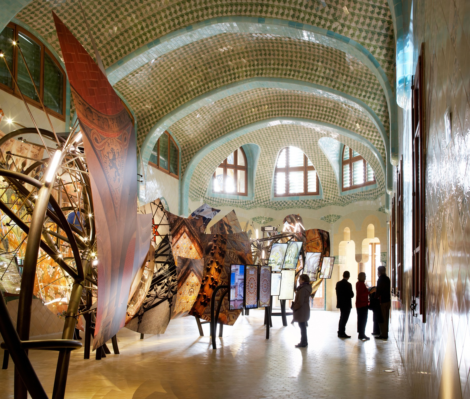 Hospital of the Santa Creu i Sant Pau. Illuminated dragon made of architectonic elements by Domènech i Montaner. Interactive screens and visitors.